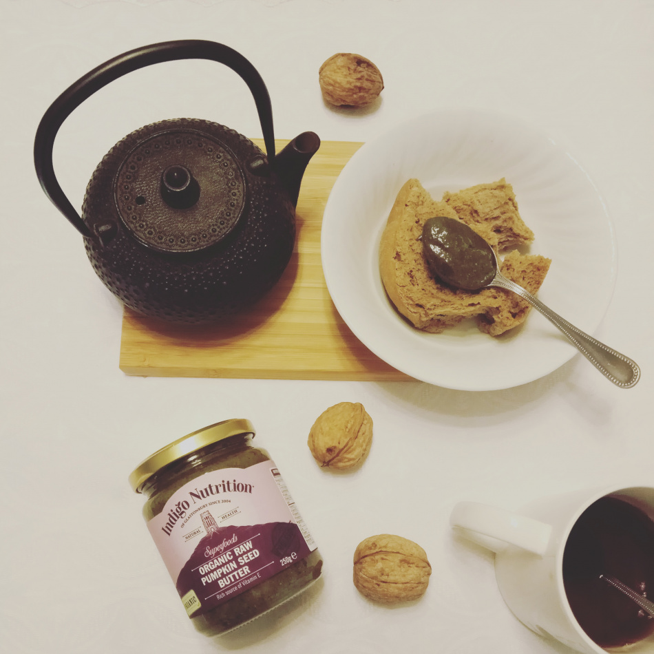 flatlay with tea and pumpkin seed butter